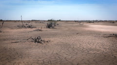 Cracked, parched, dry earth - dried up ground landscape, Africa Stock Footage