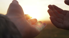 Hand mom and baby at sunset Stock Footage