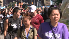 Thousands of college and university students parade on campus during frosh week Stock Footage