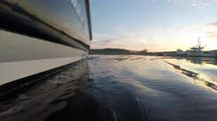 Low shot of large boat during sunset on the calm ocean Stock Footage