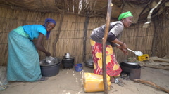 Poor African village and people - women cooking, Africa, Senegal Stock Footage