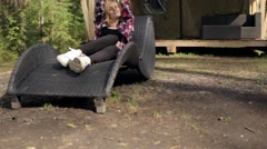 Woman Resting on a Lounger Beside a Tent in the Woods Stock Footage