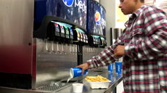 Young man selecting cool fountain drink from self service soda machine Stock Footage