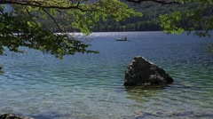 Unrecognizable male kayaking on Bohinj lake in Slovenia Stock Footage