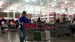 One side of busy check out counter inside Costco store Stock Footage