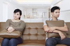 Young couple having problems at home Stock Photos