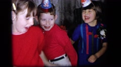 1964: playful and smiling kids dance and twist at a birthday party CAMDEN Stock Footage