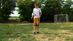 Teenager foot throws the ball Stock Footage