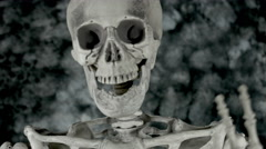 4k Science Shot of a Skeleton in Anatomy Lab waving at camera Stock Footage
