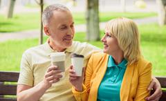 Husband and wife enjoying hot drink together Stock Photos
