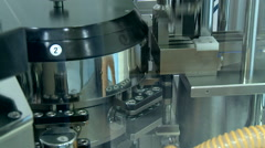 Pills falling out of pill manufacturing machine. Stock Footage