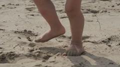 Children's legs running on the sand Stock Footage