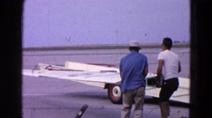 1964: loading the airplane wings. COTTONWOOD, ARIZONA Stock Footage