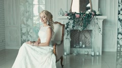 The girl in a wedding dress smiling and glancing from side to side Stock Footage
