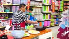 Sales of the frying pot and cooking utensils, in the Carrefour supermarket Stock Footage