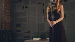 Jazz vocalist in elegant dress perform on stage at microphone. Dark pomade Stock Footage