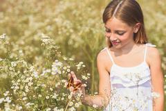 Kind female child enjoying nature Stock Photos
