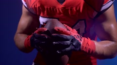 Muscular American football player training with ball Stock Footage
