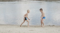Children playing on the beach Stock Footage