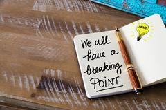Written text WE ALL HAVE A BREAKING POINT Stock Photos