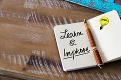 Written text LEARN AND IMPROVE Stock Photos