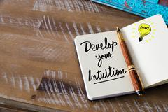 Written text DEVELOP YOUR INTUITION Stock Photos