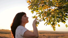 Girl touched the branches of trees Stock Footage