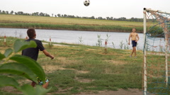 A young man hits a ball head Stock Footage