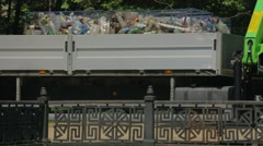 Truck With Garbage Driving Along River Bank Stock Footage