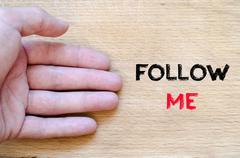 Follow me text concept Stock Photos