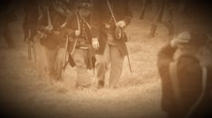 Civil War soldiers marching across field (Archive Footage Version) Stock Footage