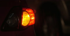 Car with hazard lamps at rainy night Stock Footage