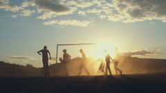 Group of youth playing ball outside. RAW video record Stock Footage