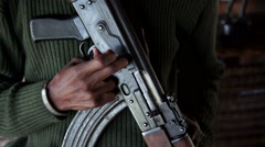 An African man with a machine gun in his hand. Stock Footage