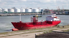 Large red ship docked in the port Stock Footage