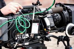 Video camera in the hands of TV operator Kuvituskuvat