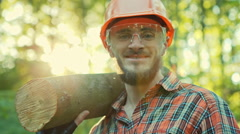Logger in hard hat standing in the woods. RAW video record Stock Footage