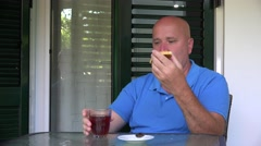 Man Sitting on the Table and Taking Breakfast in His Apartment Balcony. Stock Footage