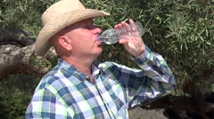 Thirsty Farm Owner Inspecting His Olive Tree Plantation Drinking Fresh Water.  Stock Footage