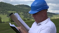 Businessman Engineer Activity Looking Agenda Notes Check Future Building Site. Stock Footage