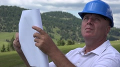 Construction Company Manager Looking on Plan Draw Verifying  Site Emplacement. Stock Footage