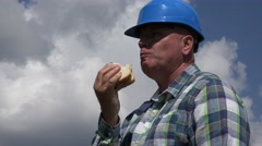 Starved Businessman Engineer Eating a Tasty Sandwich in Working Lunch Time Stock Footage