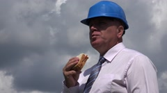 Presentable Manager Starved Taking a Lunch Break and Eating a Tasty Sandwich. Stock Footage