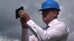 Handsome Engineer Image Using Touch Tablet Access Internet Financial Database.  Stock Footage