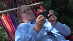 Employee Resting in a Hammock Use Mobile Phone for Sending and Read E-Mail. Stock Footage