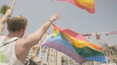 Jewish Man in yarmulke / kippah with rainbow flag, Tel Aviv, Israel Stock Footage
