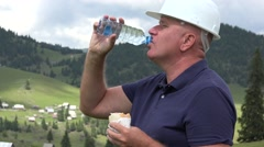 Employee Working Break in Construction Site Eating Lunch and Drinking Water. Stock Footage