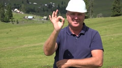 Worker Smiling Showing Winner Hand Sign Satisfied About a Good Work Result. Stock Footage