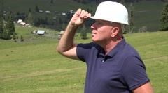 Serious Workman Standing Looking to Construction Site Activity Around Him.  Stock Footage