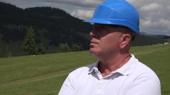 Construction Site Manager Wearing Protective Helmet Inspecting Working Field. Stock Footage